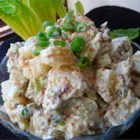 Beaumont Ranch Potato Salad - A special potato salad recipe from a special place, the 800-acre Beaumont Ranch in Texas. The potatoes are seasoned with a garlicky salad dressing while still hot, then cooled and mixed with bacon, celery, green onion, dill pickle, and mayonnaise. It makes a big batch.