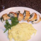 Cottage Cheese Spinach Chicken - Cajun-seasoned chicken breast stuffed with a cottage cheese and spinach mixture, then baked in butter. Serve with tossed salad, if desired.