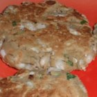 Akki Rotti - Green mung beans, soaked overnight, are mixed with rice flour, coconut, vegetables, and spices in this nutritious breakfast bread, snack, or lunch. Serve with the chutney or pickle of your choice.