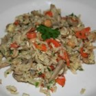 Home-Style Brown Rice Pilaf - While the brown rice is bubbling on the stove, onions, carrots, garlic, chickpeas, and mushrooms are sauteed in butter until cooked and the flavors are mingled. Eggs are swirled into the pan, the rice is added, and then a nice smattering of parsley and cashews.