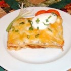 Mexican Lasagna - Lasagna noodles are baked with an earthy blend of beef, refried beans, oregano, cumin and garlic, with salsa spooned over. Topped with sour cream, green onions, olives and Pepper Jack cheese, the casserole gets one more brief baking to melt the cheese.