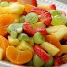 Tangy Poppy Seed Fruit Salad - Pineapple, orange, kiwi, grapes and strawberries tossed with a sweet, lime and poppy seed dressing.
