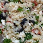 Orzo Pasta Salad - A Mediterranean-inspired orzo salad has the flavors of sun-dried tomatoes, feta cheese, Greek olives, and lemon.