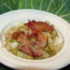 Wilted Cabbage Salad with Bacon - Bacon is the star. It's browned and crumbled and all the other ingredients are lightly sauteed in the bacon drippings --onion, garlic, vinegar, and shredded cabbage. Serve warm.