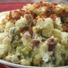 Red Skinned Potato Salad - A creamy potato salad chock full of melt-in-your-mouth bacon, bits of hard boiled egg, crunchy celery and spicy onion.
