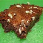 Melt in Your Mouth Mint Brownies - A brownie made from a mix is topped with chocolate mint candies when hot to create a stunning green and chocolate swirl decoration.