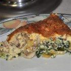 Spinach and Bacon Quiche - Spinach, Cheddar cheese, bacon, eggs, and cream make up the delectable filling for this yummy quiche, which is made with a premade pie crust.