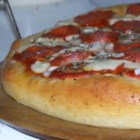 Pizza Crust for the Bread Machine II - Bread flour has a higher gluten content and so makes a durable dough that holds its own against the weight of all the yummy pizza toppings.