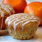 Carrot Cake Muffins with Cinnamon Glaze - Tasty muffins full of carrot, pineapple, and coconut with a tangy, spicy buttermilk glaze!