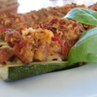 Stuffed Zucchini with Chicken Sausage - Zucchini get a light and tasty stuffing of Italian chicken sausage, sweet onion, tomato, and Parmesan cheese before being baked.
