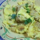 Knodel - This Austrian dumpling casserole bears a resemblance to bread pudding.  In this savory dish, stale bread is tossed with onions, parsley, and a simple custard batter and baked in a water bath.