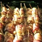 Bacon Roll Ups II - These appetizers are so easy to make! Cream cheese is rolled up in bread wrapped with bacon and toasted golden brown. Be sure to have toothpicks on hand to secure these succulent appetizer bites!