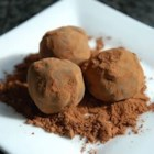 Chocolate Orange Truffles - Use orange liqueur or orange juice to flavor these dipped truffles. This is a very easy recipe, requiring no candy thermometer and no sensitive tempering of the chocolate.