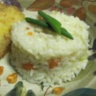 Carrots and Rice - Creamy rice and sweet, buttery carrots go with just about any meal. This recipe was a specialty of my mother's. It has been served in our family for Thanksgiving and Christmas for over 25 years, but it can be served anytime. It is very rich and quite delish.