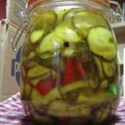 Bread and Butter Pickles II - Cucumber slices, onions, peppers and garlic are pickled in an exciting spicy cider vinegar mixture! What a great way to end the summer!