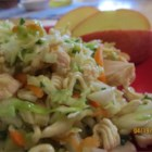 Nell's Cabbage Salad - Cabbage, green onion, ramen noodles and toasted almonds are dressed with a highly seasoned vinegar and oil dressing and chilled. The salad that emerges a few hours later from the fridge is robust and delicious.