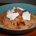 Tomato Basil Spaghettini - This pungent garlic, basil, and tomato sauce will delight the senses. The goat cheese is the perfect creamy complement to an already delightful dish!