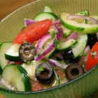 Cucumber Tomato Salad with Zucchini and Black Olives in Lemon Balsamic Vinaigrette - Enjoy this veggie salad while the cucumbers, tomatoes, and zucchini are ripe on the vines. A lemon-scented vinaigrette dressing, fresh basil, thyme and black olives add their flavor and color.