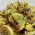 Yellow Squash - I combined an element of stir fry with some ingredients I had seen popping up in other squash recipes. Squash, onion and jalapeno are fried with bacon for a tasty summer side dish.