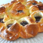 Pull-Apart Easter Blossom Bread - A rich eggy dough is twisted into pretty flowers, then filled with jam and drizzled with lemon glaze for an Easter bread that will become a new tradition at your house. Pull it apart into petals to serve. Be sure to look at the pictures for how it is formed.