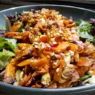 Roasted Carrot Salad - Thinly sliced carrots are roasted, then tossed with almonds, dried cranberries, and blue cheese in this award winning salad.