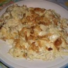 Easy Turkey Tetrazzini - An easy, quick turkey dish that turns precooked turkey into a family favorite. Cooked turkey is combined with mushrooms, celery soup and sour cream, then baked in a dish with noodles.