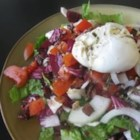Salade Lyonnaise - A simple salad with smoky bacon and a perfectly poached egg is served with a delicious homemade dressing made in the style of Lyon, France.