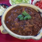 Slow Cooker Chicken Mole - A unique blend of spices and cocoa powder turns into a rich and complex mole sauce after a long simmer in the slow cooker. Along with the tender chicken, it's a great filler for soft tortillas, or as a dip with corn chips.