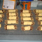 Chocolate Chip Shortbread Cookie Logs - Delicious shortbread logs with chocolate chips in the cookie and dipped in chocolate and nuts on the end.