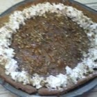 Chocolate Pecan Pie - This is made just like a traditional pecan pie, with the addition of chocolate chips. It is very fudgy. It is always the first dessert to go at our family's Thanksgiving! Originally submitted to ThanksgivingRecipe.com.