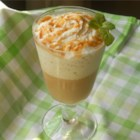 Frozen Caramel Latte - This frothy, blended espresso drink will wake you up and make you happy any time of day. Sweetened with caramel sauce and topped with whipped cream, this is one delicious frozen latte.