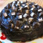 Caramel Nougat Cake II - Layer cake make with candy bars, frosted and drizzled with melted caramel. M-m-mmmm!