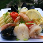 Ocean Packets - Make a seafood bake on your grill using foil packets to contain shrimp, clams, scallops, corn on the cob, and cherry tomatoes, all drizzled with lemon butter.