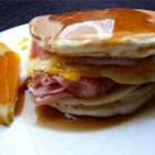 Leftover Pancake Breakfast Sandwich - Ham, cheese, and a fried egg are sandwiched between two buttermilk pancakes and covered with syrup. A great way to use up leftover pancakes!