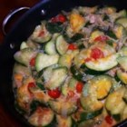 Skillet Zucchini - Zucchini is sauteed with onion, tomatoes, bacon, and cheese. Great as a side or as a vegetarian main.