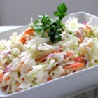 Restaurant-Style Coleslaw I - This salad has the perfect coleslaw taste. Very, very creamy with a bit of sweet/tartness stirred in. Everything is stirred into one bowl, and then chilled before serving. Makes six generous servings.