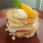 Baby Blintz Stacks - Tiny vanilla and nutmeg-scented pancakes are stacked five tall with a filling of cottage cheese and fresh peaches in this delicious dessert.