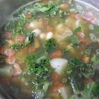 Vegetarian Kale Soup - This wonderful soup will warm your insides, delight your taste buds, and fill your stomach on a cold winter's night. It is full of dark green kale, potatoes, and cannellini beans.