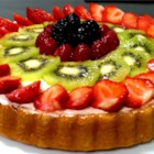Fresh Fruit Flan - A beautiful fresh fruit dessert with strawberries, blueberries and kiwi, this is not your regular 'fruit pizza.'  You can substitute other favorite fruits or berries for those in this recipe.