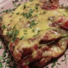Lisa's Lasagne - A colorful, tasty dish, this vegetarian lasagna is filled with zucchini, bell peppers, and homemade tomato and cheese sauces.