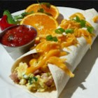 Ham and Cheese Breakfast Tortillas - Flour tortillas are filled with an egg, ham and green onion scramble to make an irresistible breakfast wrap.