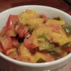 Mmmm Mango Salsa - Mangos, roma tomatoes, green chile pepper, and pineapple juice mingle in this salsa recipe.