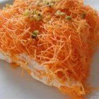 Kanafa - Crunchy shredded phyllo dough is layered with a creamy sweet cheese filling and soaked with rose water syrup in this dessert.