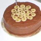 Chocolate Banana Layer Cake - A beautiful from-scratch chocolate layer cake has the smooth flavor of bananas. There's chocolate frosting, too, and you can add sliced bananas to the cake.
