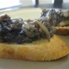 Easy Mushroom Spread - Your favorite mushrooms sauteed in butter with rosemary, garlic, parsley, vegetable stock and whiskey.  The whiskey is optional but really makes it good!  Serve cold or warm.  Great on a pita with avacado!