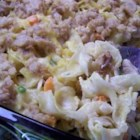 Chicken Casserole Mississippi - A filling chicken and noodle casserole with a rich sour cream-cracker crust.