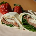 Roast Beef Horseradish Roll-Ups - Simple to make for daily lunches or party fare, these roast beef roll-ups, layered with spinach leaves and Cheddar cheese, have added zing from horseradish and Dijon mustard mixed with a cream cheese spread.