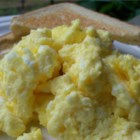 Oven Scrambled Eggs - These light and fluffy scrambled eggs  are a snap to put together for a big crowd. I usually make 2 pans for our Christmas Brunch, and I never have much left over!