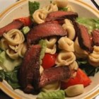 Tortellini, Steak, and Caesar - Cheese tortellini, flank steak, and salad ingredients combine to yield a filling, delicious meal!