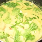 Curried Spinach Soup - A creamy spinach soup with just a hint of curry. I absolutely LOVE this soup and make it all the time.  I've adapted the recipe to be more healthy by using olive oil instead of butter and fat-free sour cream. Serve topped with croutons.